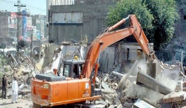 Town to take action against illegal buildings