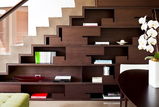 The space around stairs is often ignored and left unattended. Utilising this place creatively to serve as the more functional part of your home has to be part of the construction plan. You can use the space both as decoration and storage area and change its look from time to time.