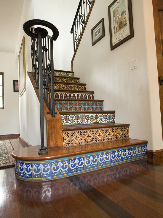 This one is very effective way of giving your existing staircase a makeover. With flashy ceramic and mosaic tile, add life and vibrancy in every step of the staircase. You can also use wall papers, stickers and handmade posters to customise your staircase.