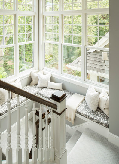 This one is my favourite. If you plan to have huge windows around your staircase to let light and air in, adding a small sitting area around will only increase the functionality of the space. In late afternoons of winter, you will often find yourself reading a book here.
