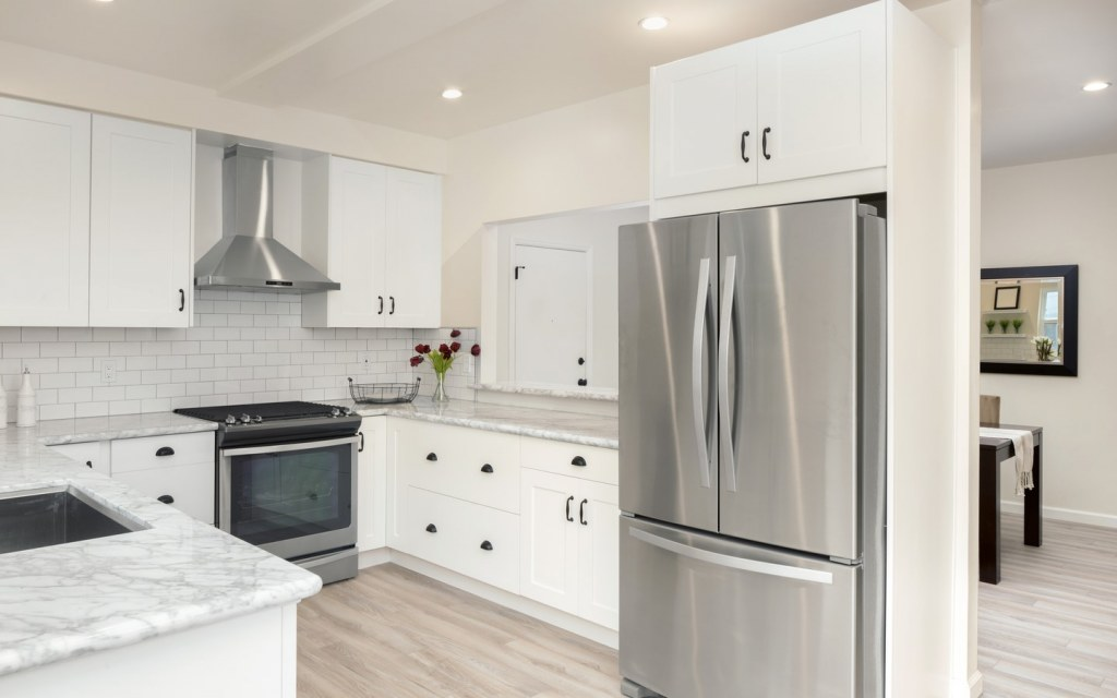 A domestic kitchen installed with stainless steel appliances