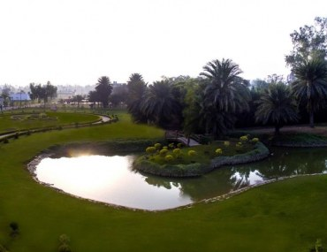 Scenic view of a park at Palm City Lahore