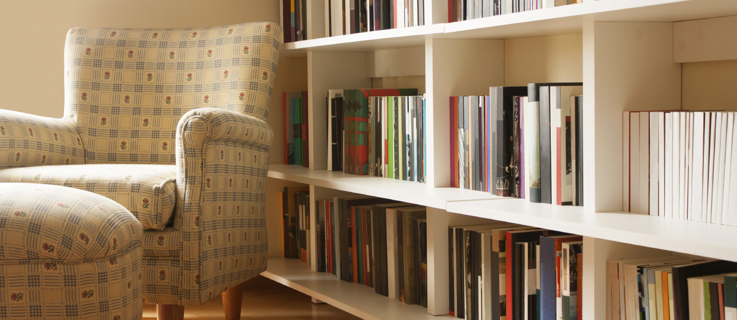 Home library bookshelf with armchair