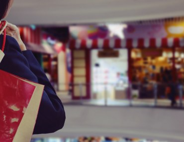 A lady having shopping bag in hand