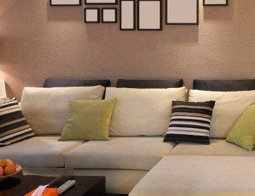 Long sofa with bright couches in modern living room
