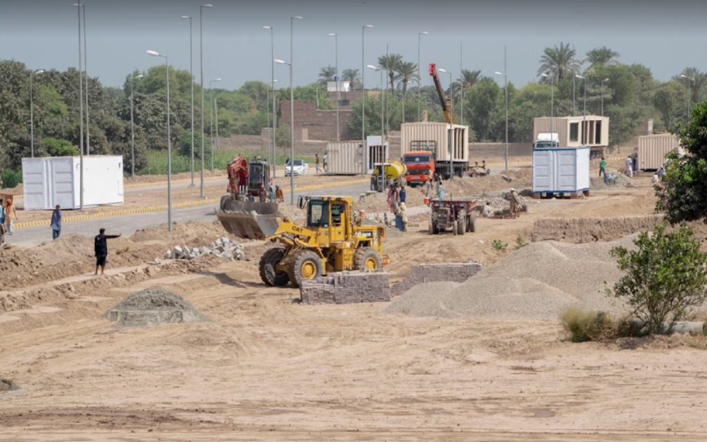 Heavy machinery carrying out development work in Citi Housing Multan