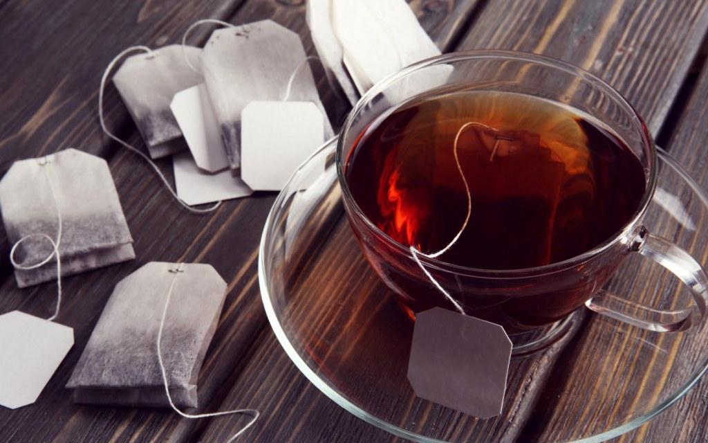 Teabags around black tea