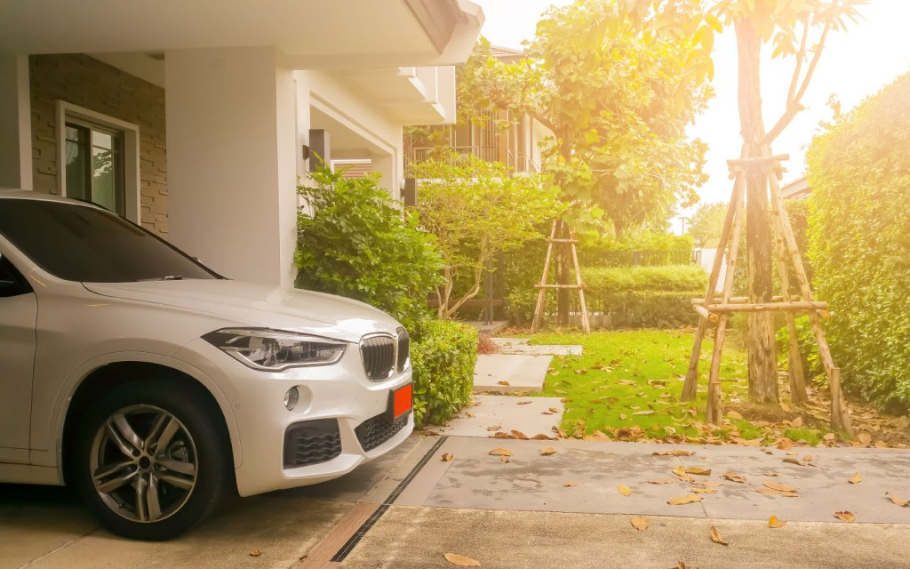 A car parked inside the garage of a modern home