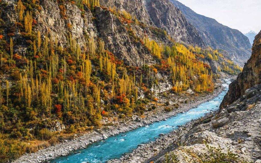 Hunza River flows along the Karakoram Highway in Gilgit Baltistan