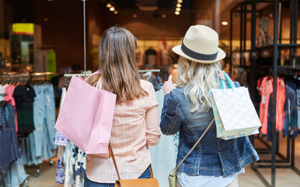 Two girls standing outside a retail outlet