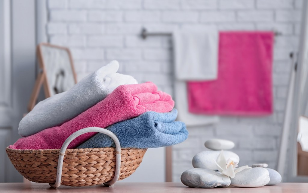 Set of colourful towels in a bathroom