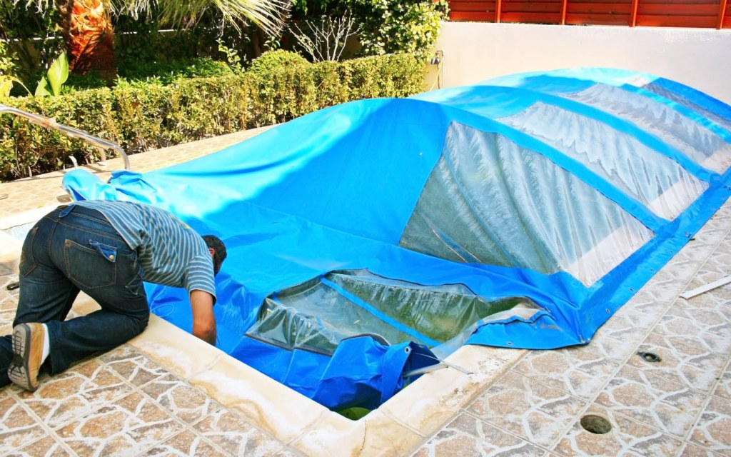 Man Covering a Swimming Pool