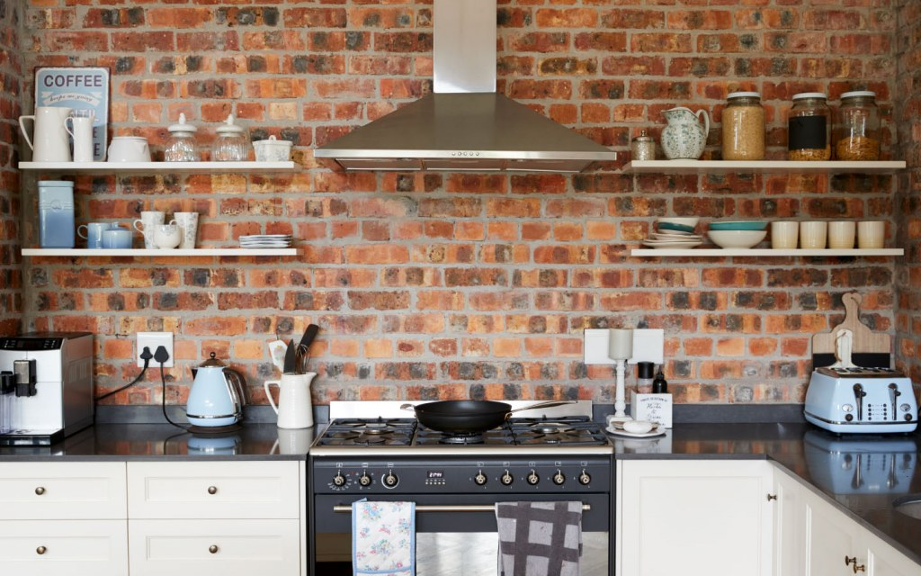 Brick-walled kitchen with open shelving