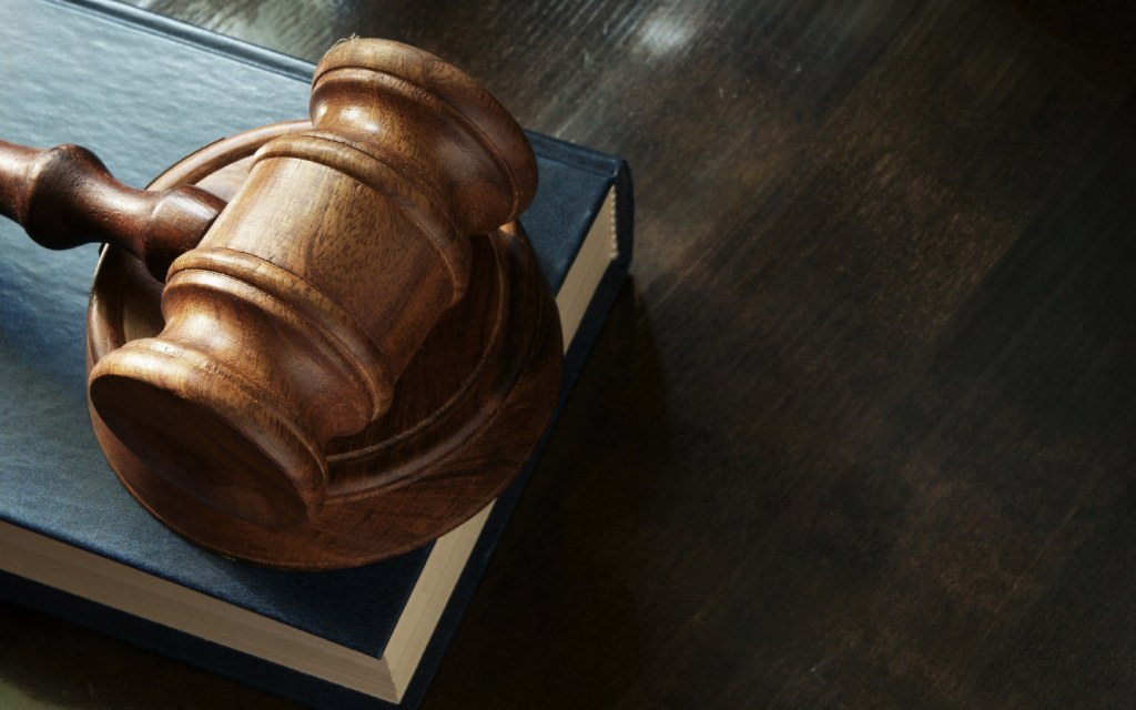 A gavel placed on a law book