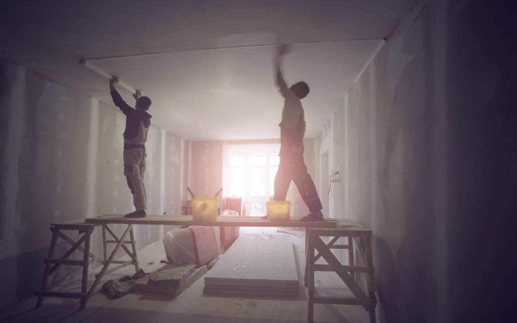 Workers installing ceiling remodeling renovation
