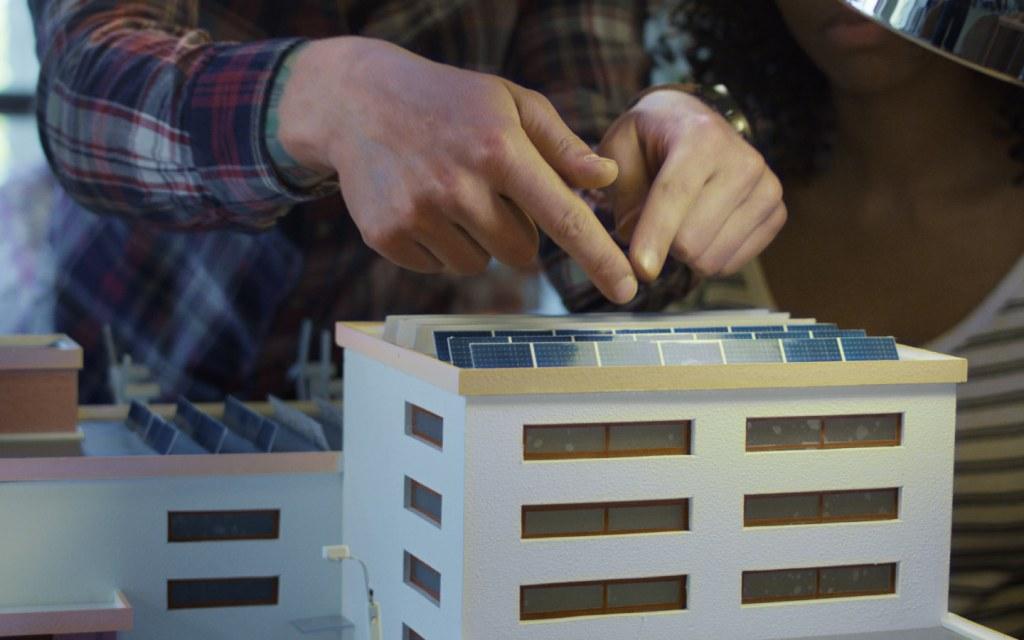 Miniature solar panels on building model