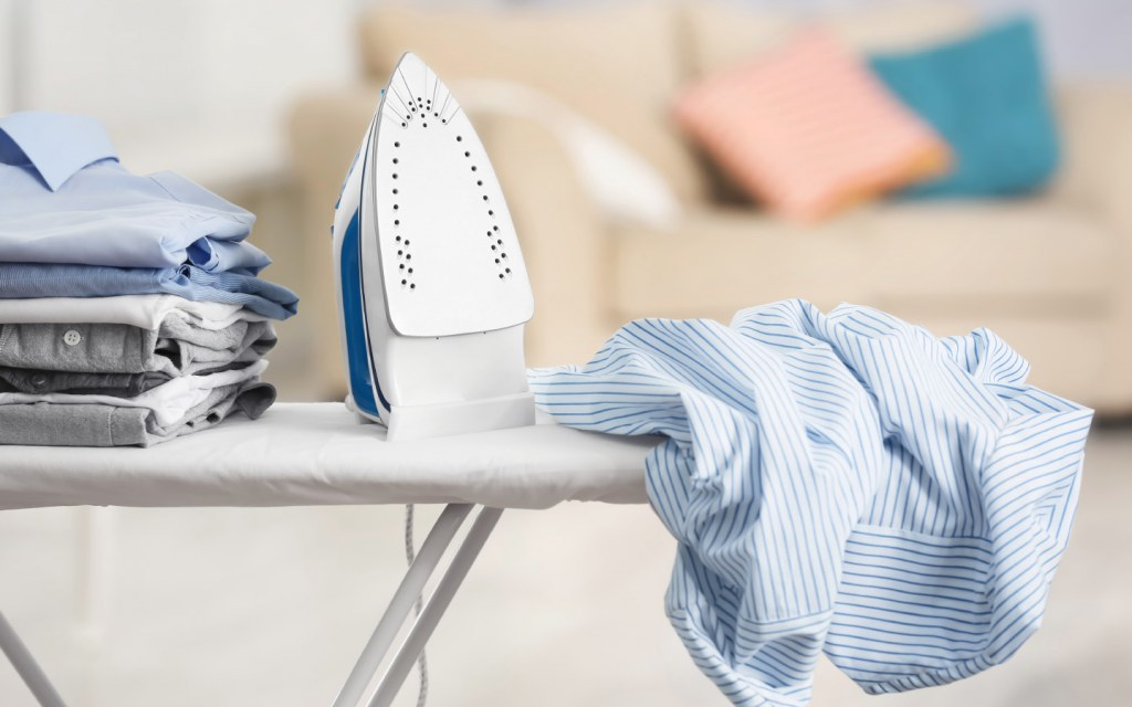 Ironing Board with Iron and Clothes