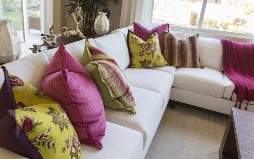 White living room couch with colourful throw pillows