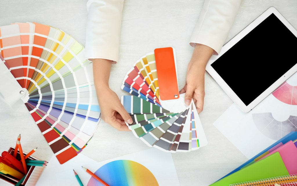 Woman looks at different colour palettes