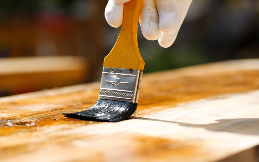 applying oil paint on wood furniture