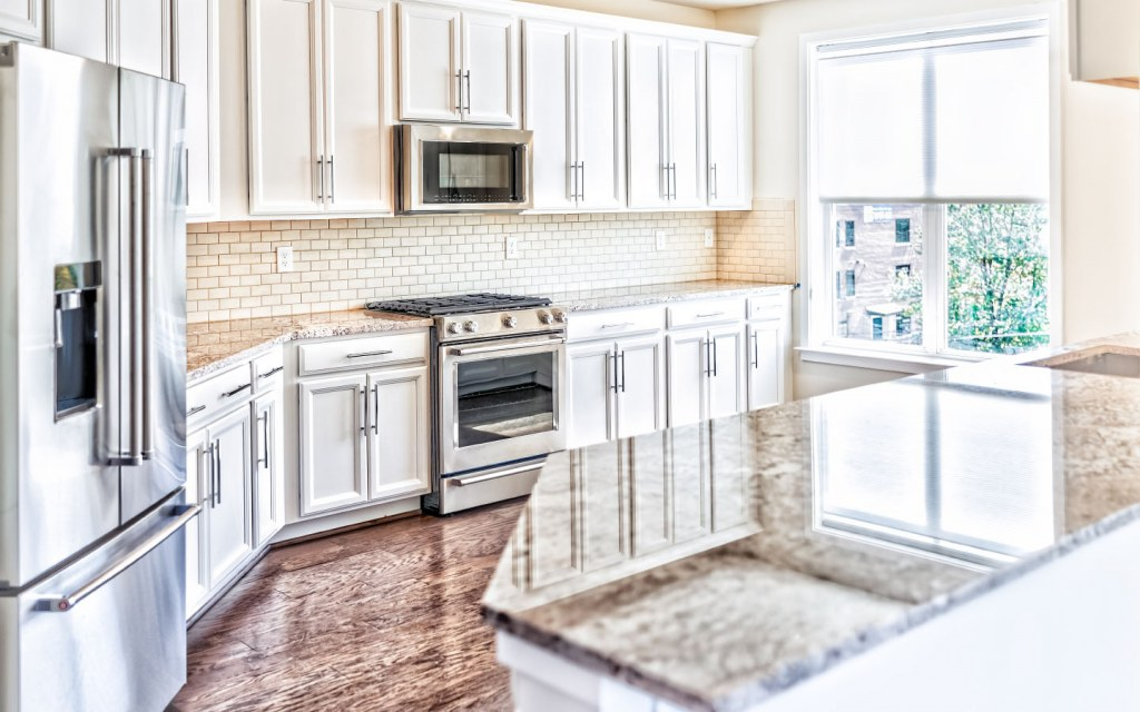 Expensive white kitchen with granite countertops