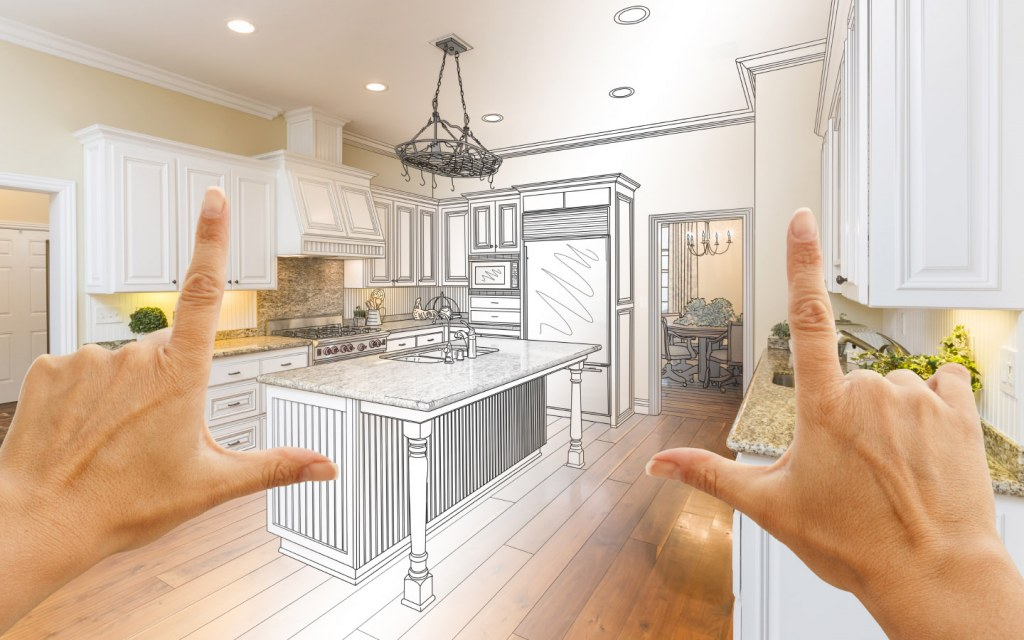 female hands framing a custom kitchen view