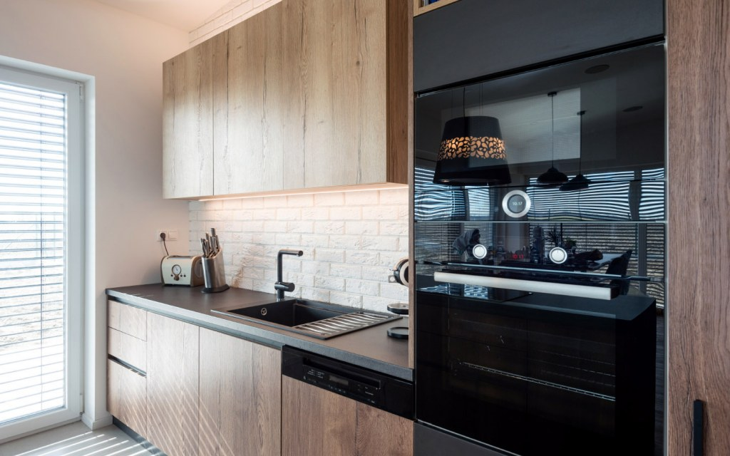 Contemporary kitchen design with integrated oven
