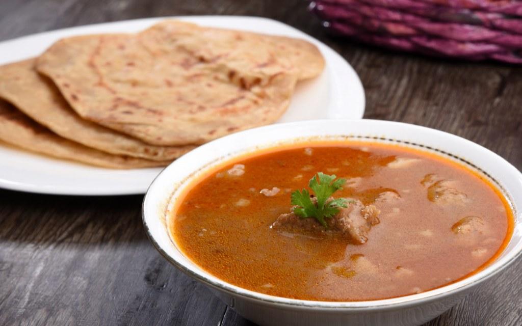 Freshly prepared Nihari served with naan