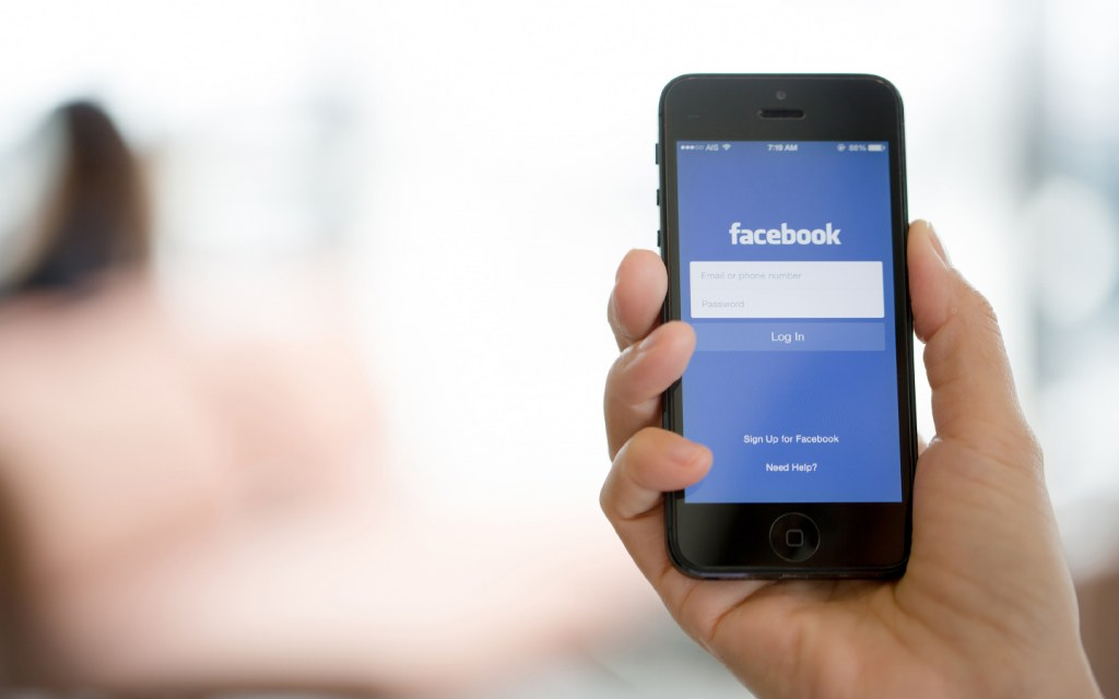 A smartphone displaying Facebook log in page