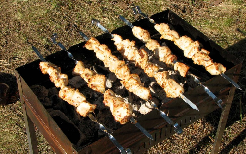 Barbecued Chicken Pieces on Grill