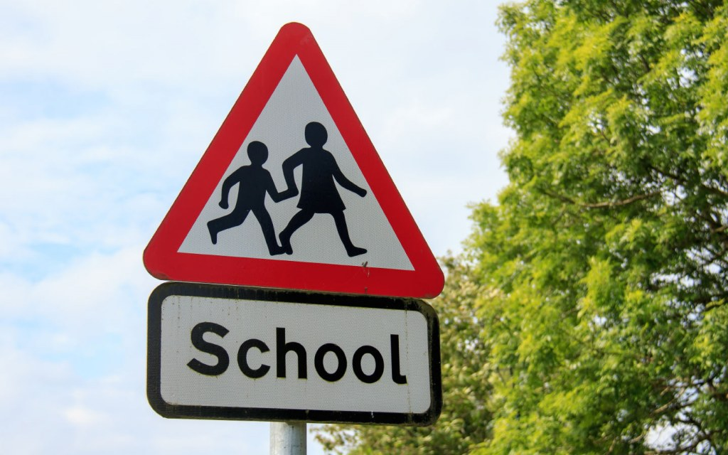 Close up of school sign on a street