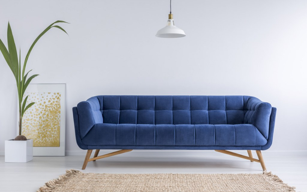 Blue couch in white  living room