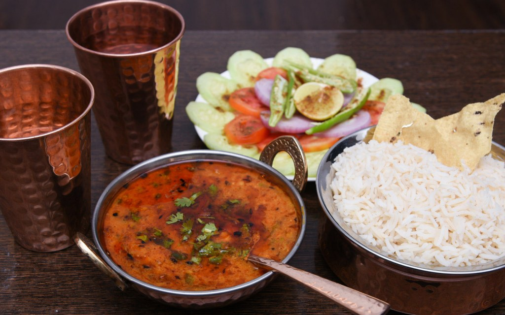 Traditional daal served with basmati rice