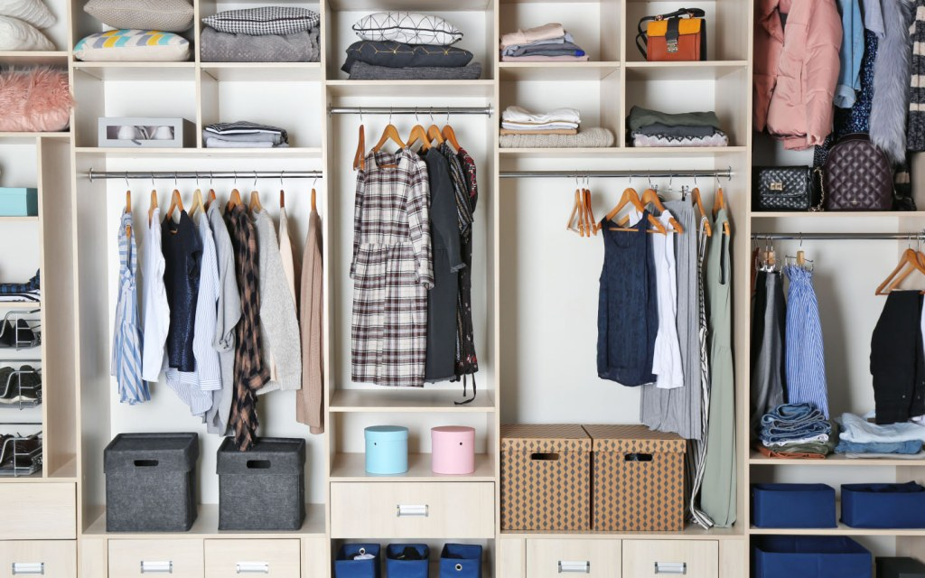 Organized closet with different clothes and home stuff