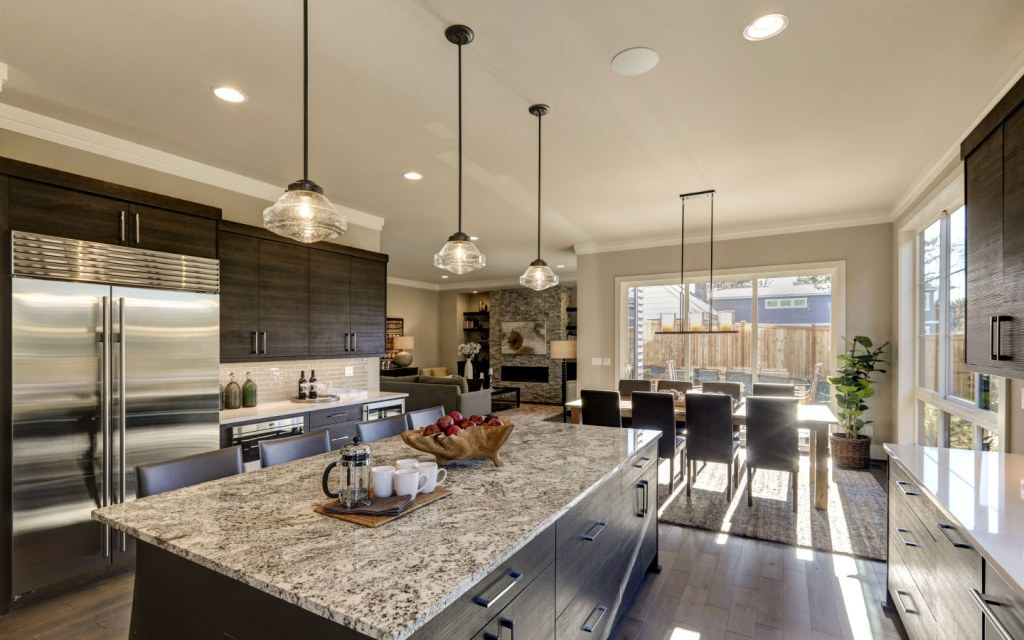 Modern gray kitchen with white quartz counter tops