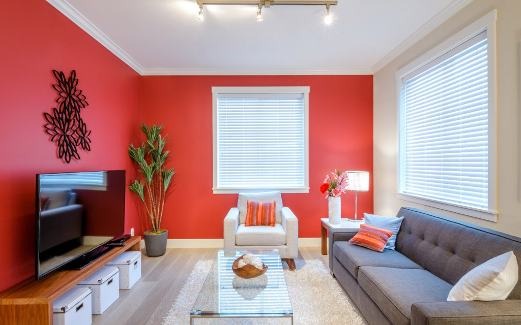 Red living room with TV and sofa set