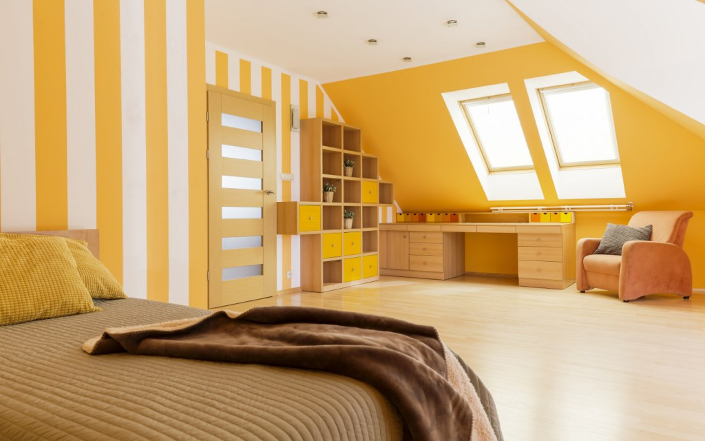 A room having a brightly coloured wallpaper