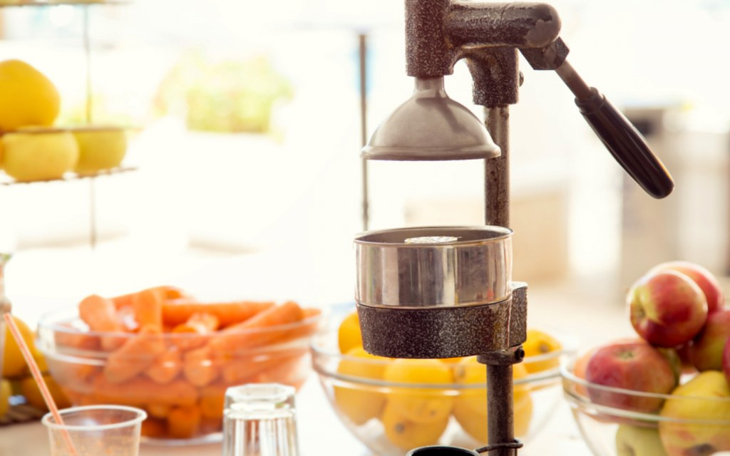 Fruit juice being freshly extracted by a machine