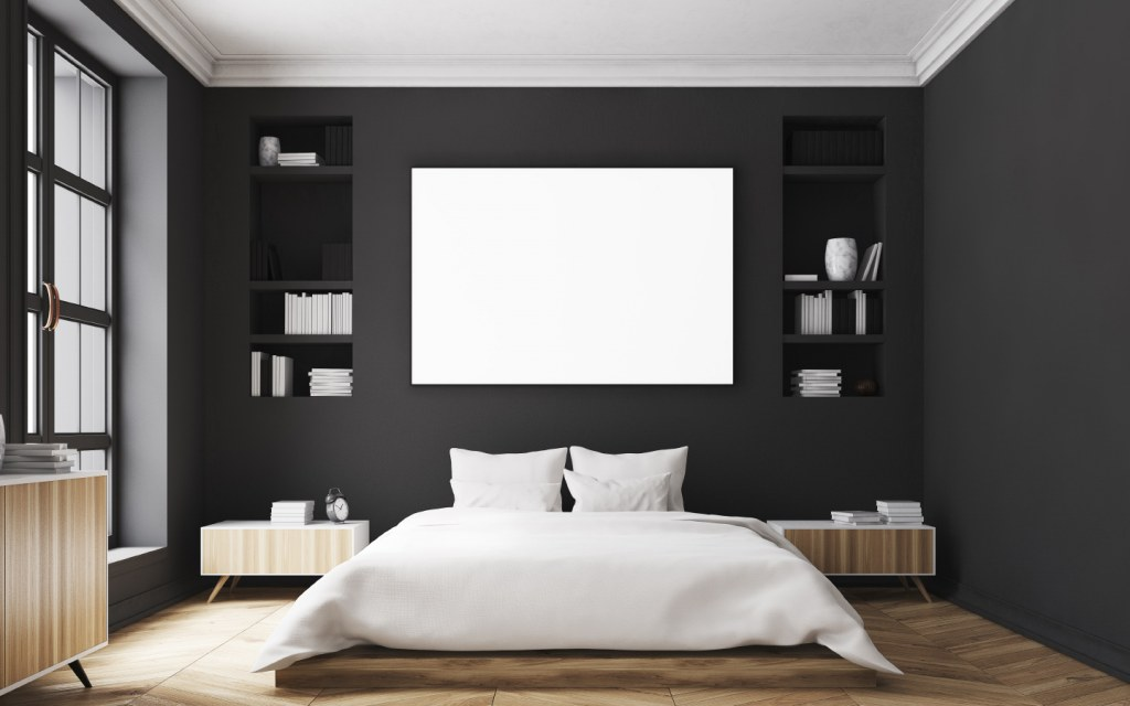 modern bedroom with black walls and a large bed in the center of the room
