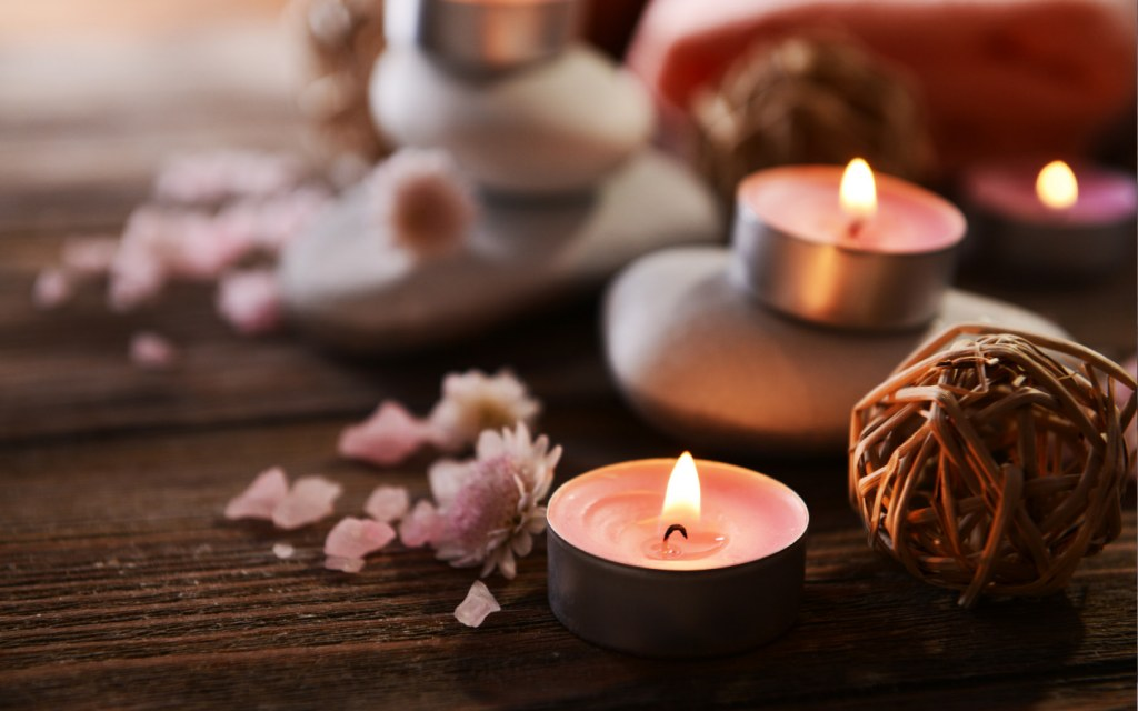 scented candles on wooden table