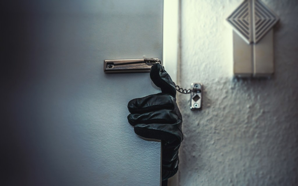 An intruder trying to enter a house