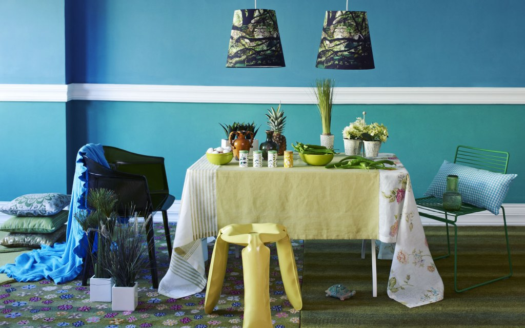 Vibrant blue dining room with plants on the table