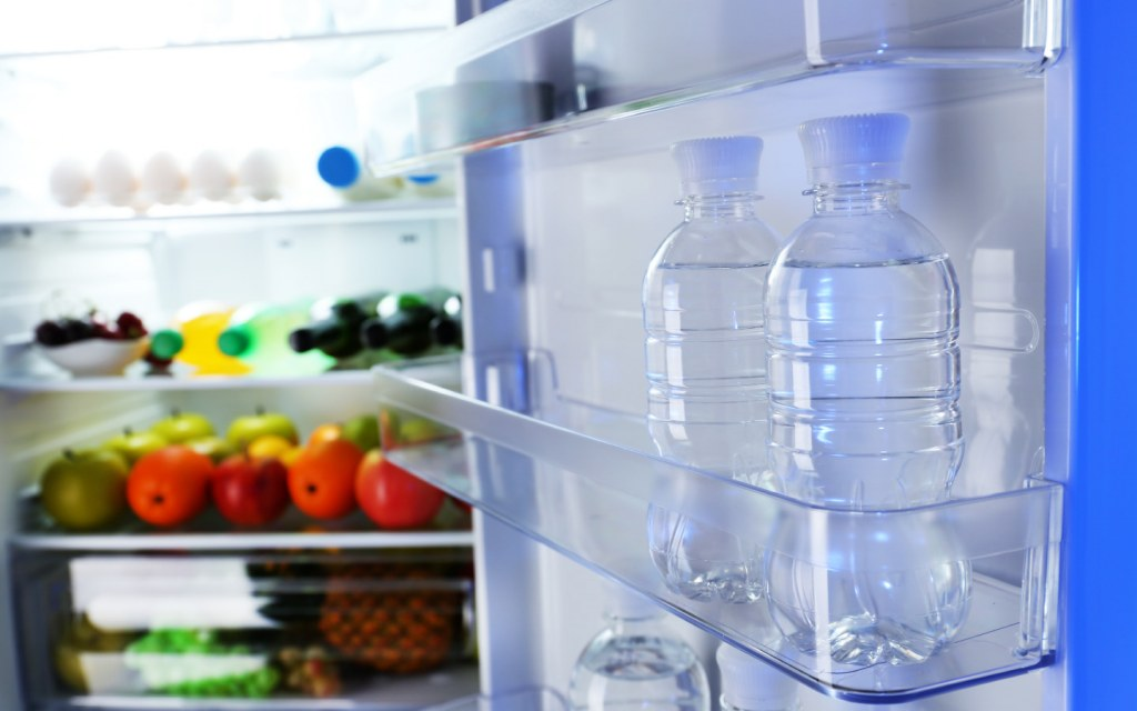 Transparent water bottles in refrigerator