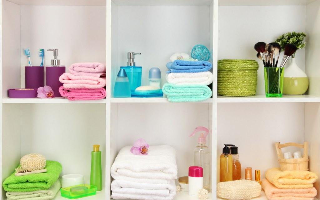 colourful towels toiletries in modern bathroom