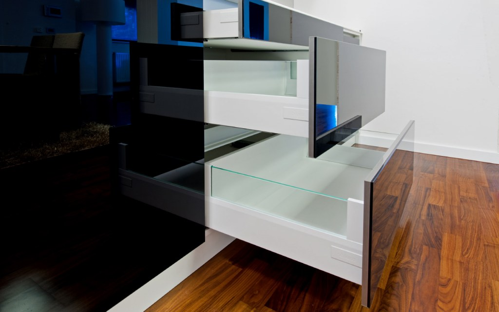 Opened deep drawers in luxury kitchen