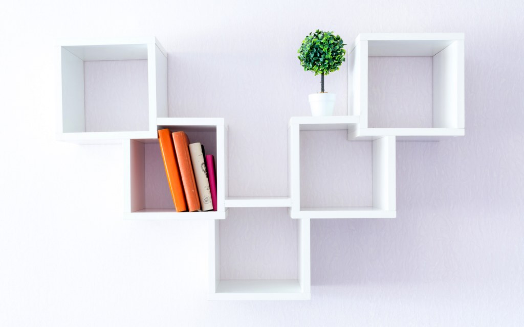 Minimalist white cube box bookshelf with plant