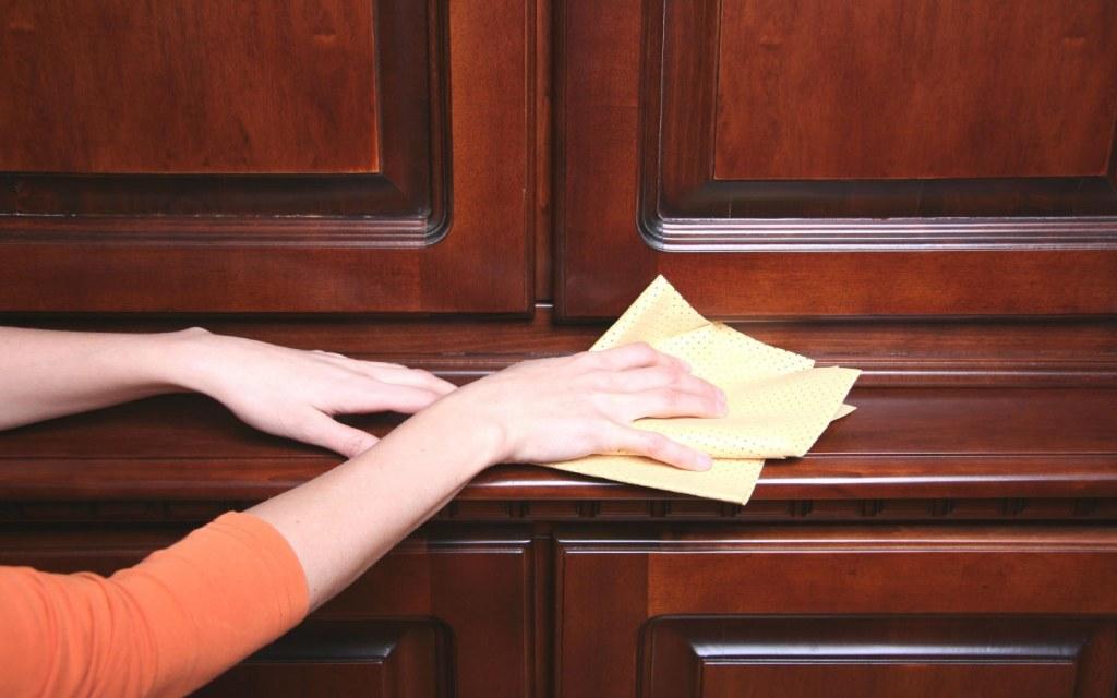 Person cleaning wooden door