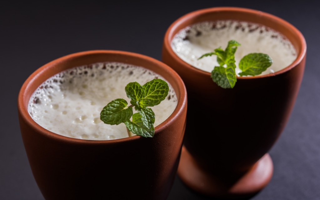 Two glasses of traditional lassi with mint