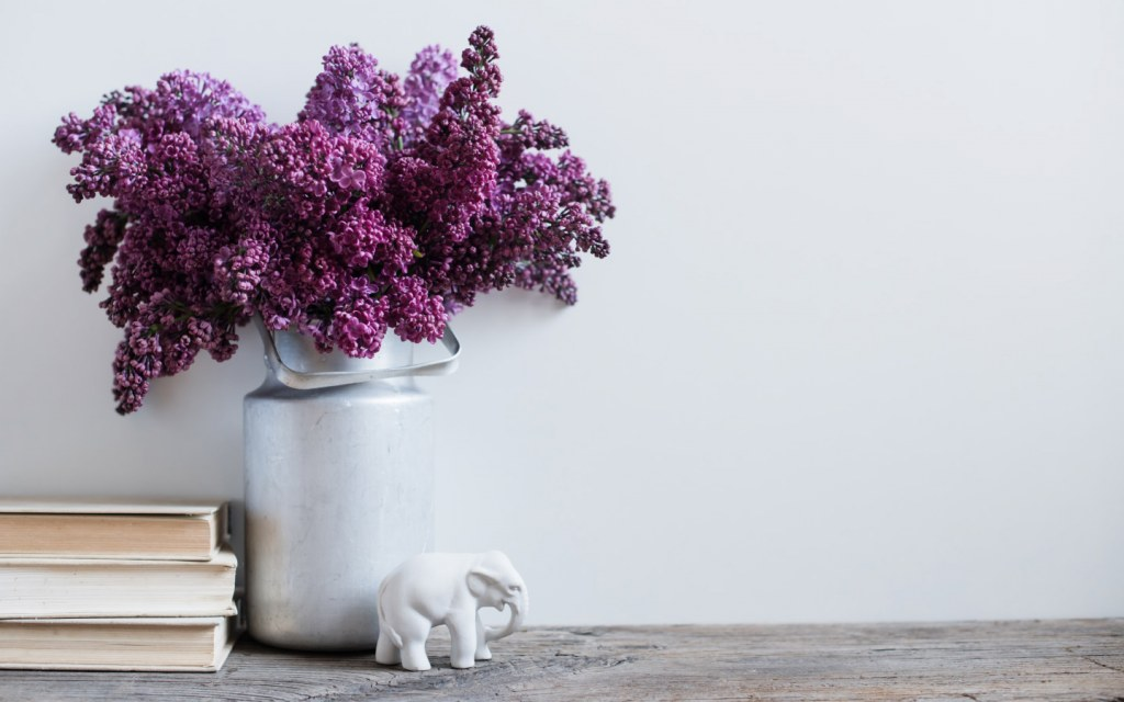 Lilacs in a vase on rustic wooden table