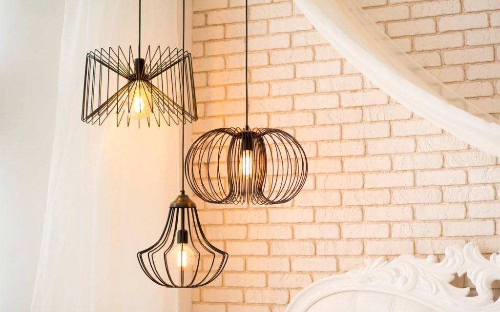 Black pendant lights hanging from the ceiling lighting